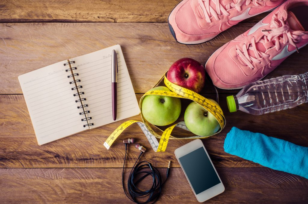 still - fitness inspired - shoes, water, notebook, running gear, tape measure