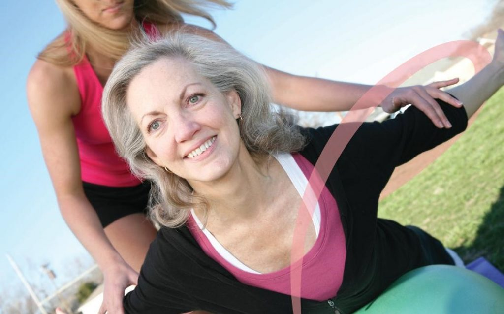 Fitness - middle aged woman practicing yoga